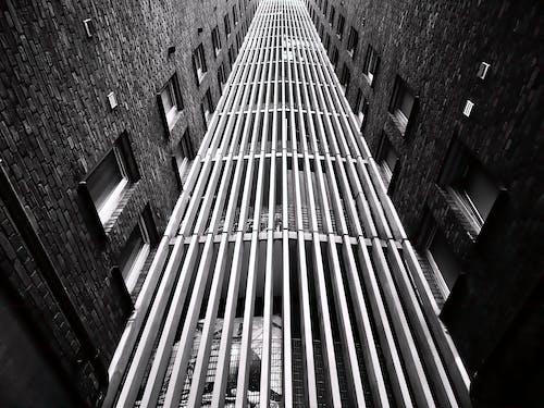 Gratis stockfoto met architectueel design, buitenkant, eenkleurig, gebouwen
