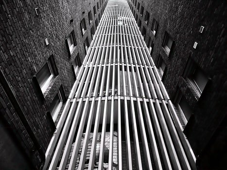 Free stock photo of black-and-white, buildings, windows, tall