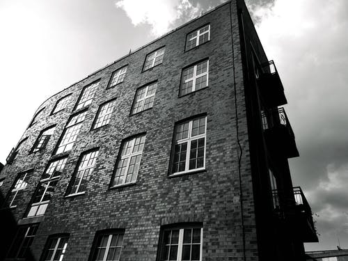 Grayscale Photography of Brick Building