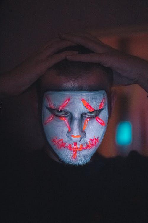 Creepy guy with Halloween mask makeup