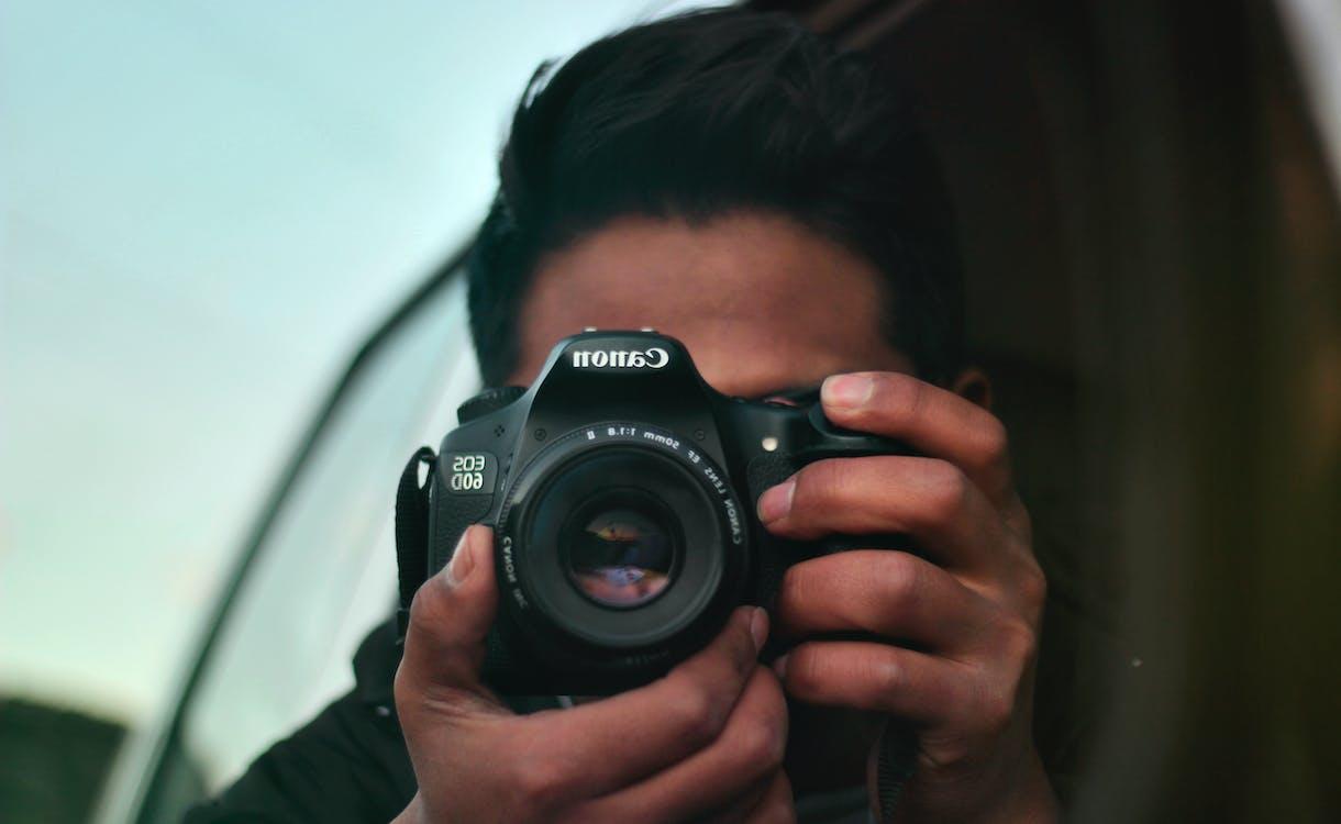 Person Shooting Canon Camera
