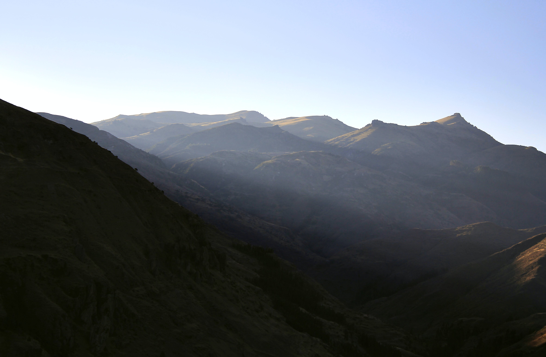 Brown Mountain Under White Sky