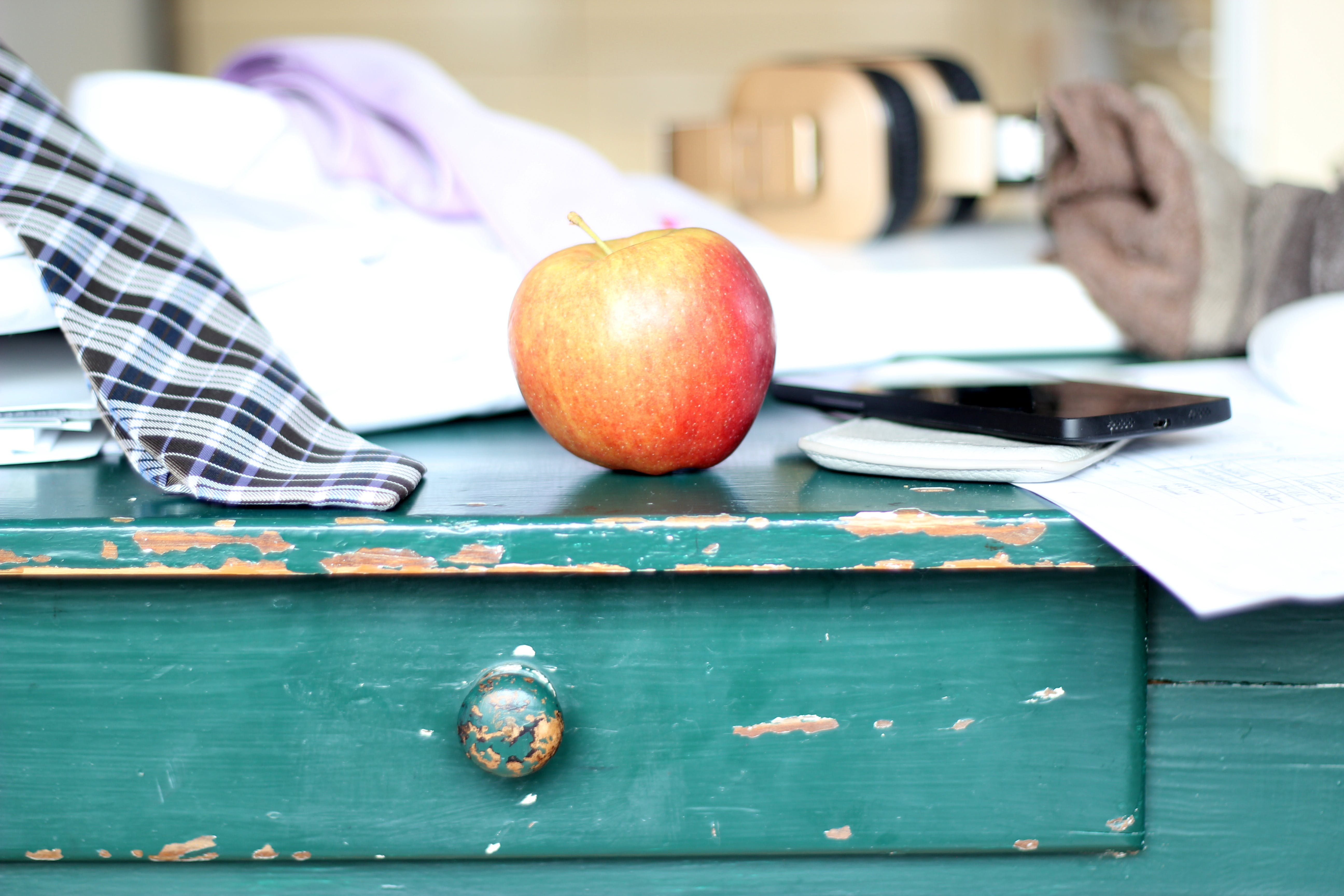 Red and Yellow Apple on Green Wooden Dresser