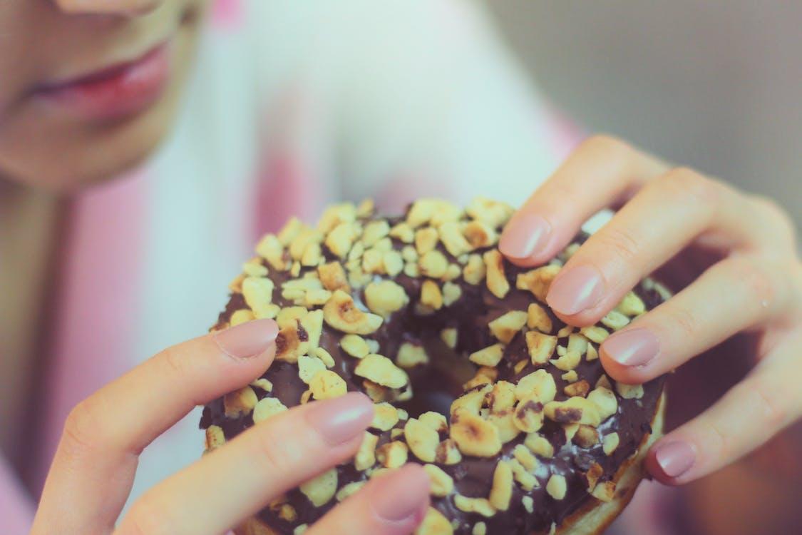 Person Holding Chocolate Doughnut