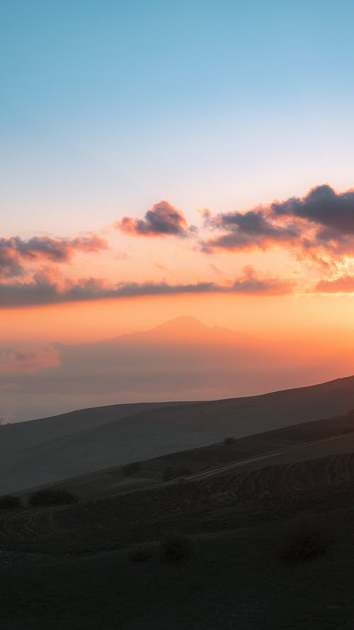 Picturesque landscape of hills on sunset