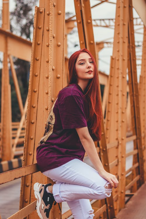 Hipster redhead woman on bridge