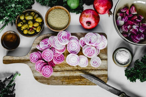 Sliced Vegetables on a Wooden Chopping Board