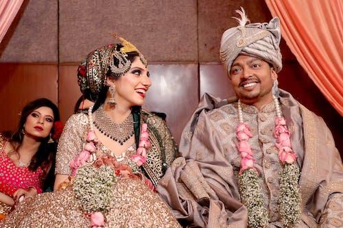 A Couple Wearing their Wedding Dress