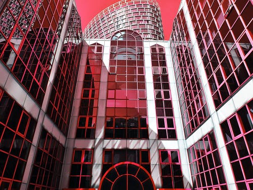 Red and Pink High-rise Building