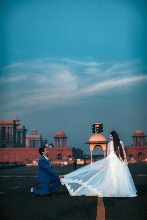 Couple in Wedding Dress Standing on the Ground