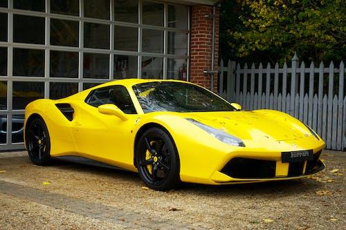 Yellow Ferrari 458 Italia Parked Near White Wooden Fence