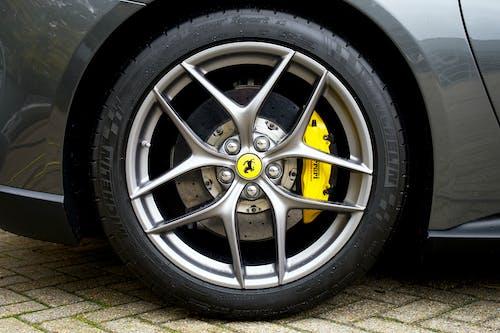 Silver 5 Spoke Car Wheel With Tire
