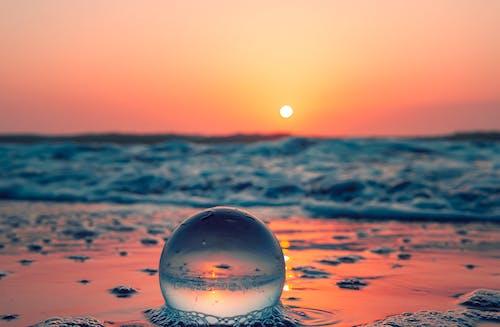 Clear Glass Ball on Beach