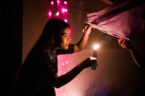 Young woman lighting sky lantern