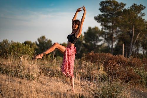 Calm dancer standing in field