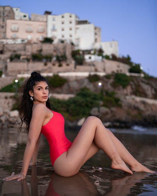 Sensual woman resting on wet seashore