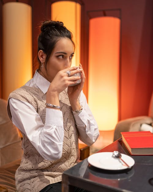 Attractive woman drinking coffee in cafe