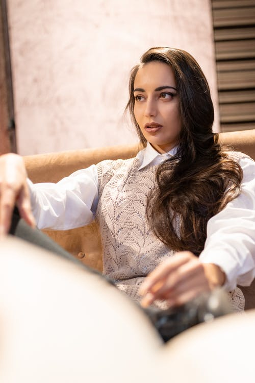 Attractive woman sitting on cozy couch