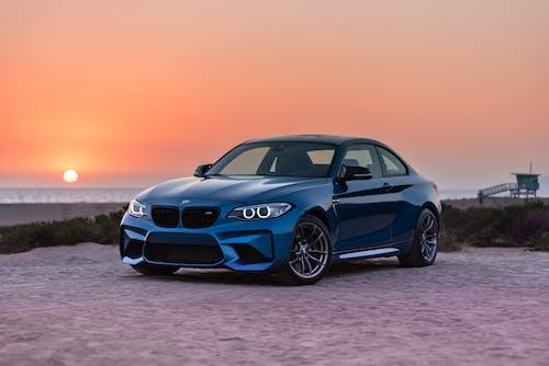 Blue BMW Sports Car Parked Near the Beach