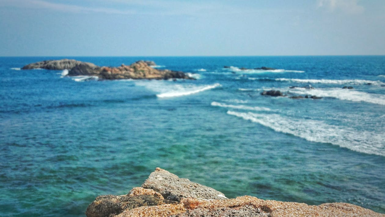blue sky, blue water, rock