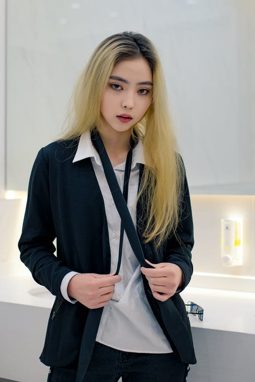 Serious Asian woman in office outfit