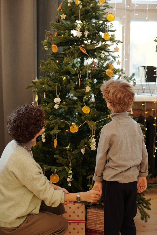 Mom and Son Looking at the Christmas Tree