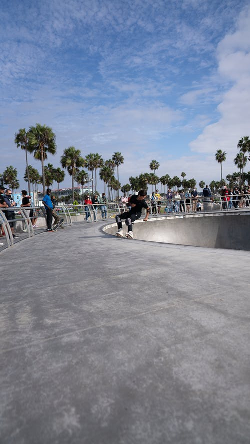 Anonymous skater performing trick on ramp