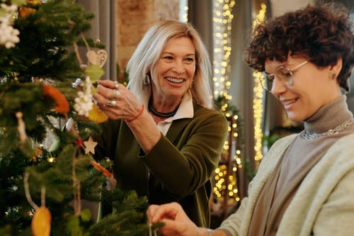 Mother and Daughter Decorating a Christmas Tree