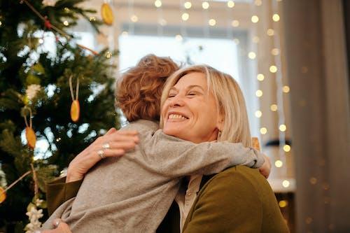 Shallow Focus of a Grandmother Hugging Her Grandson