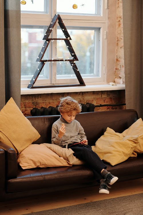 Boy Sitting on a Sofa