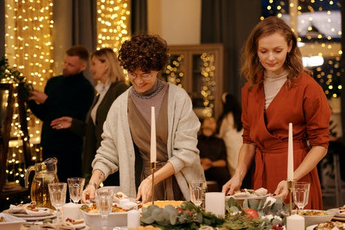 Two Women Preparing Table Set-Up for Christmas Dinner
