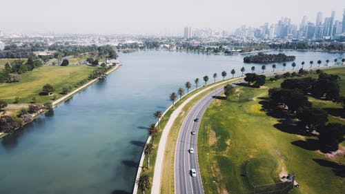 Aerial View of Highway Near Body of Water
