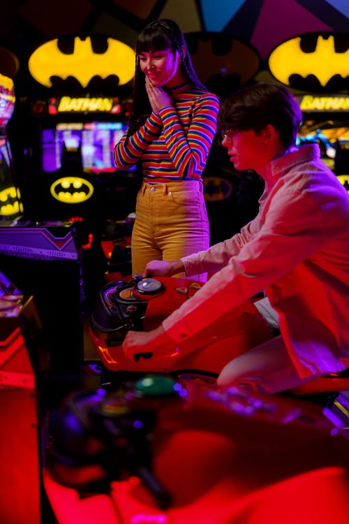 Child Playing With Arcade Game