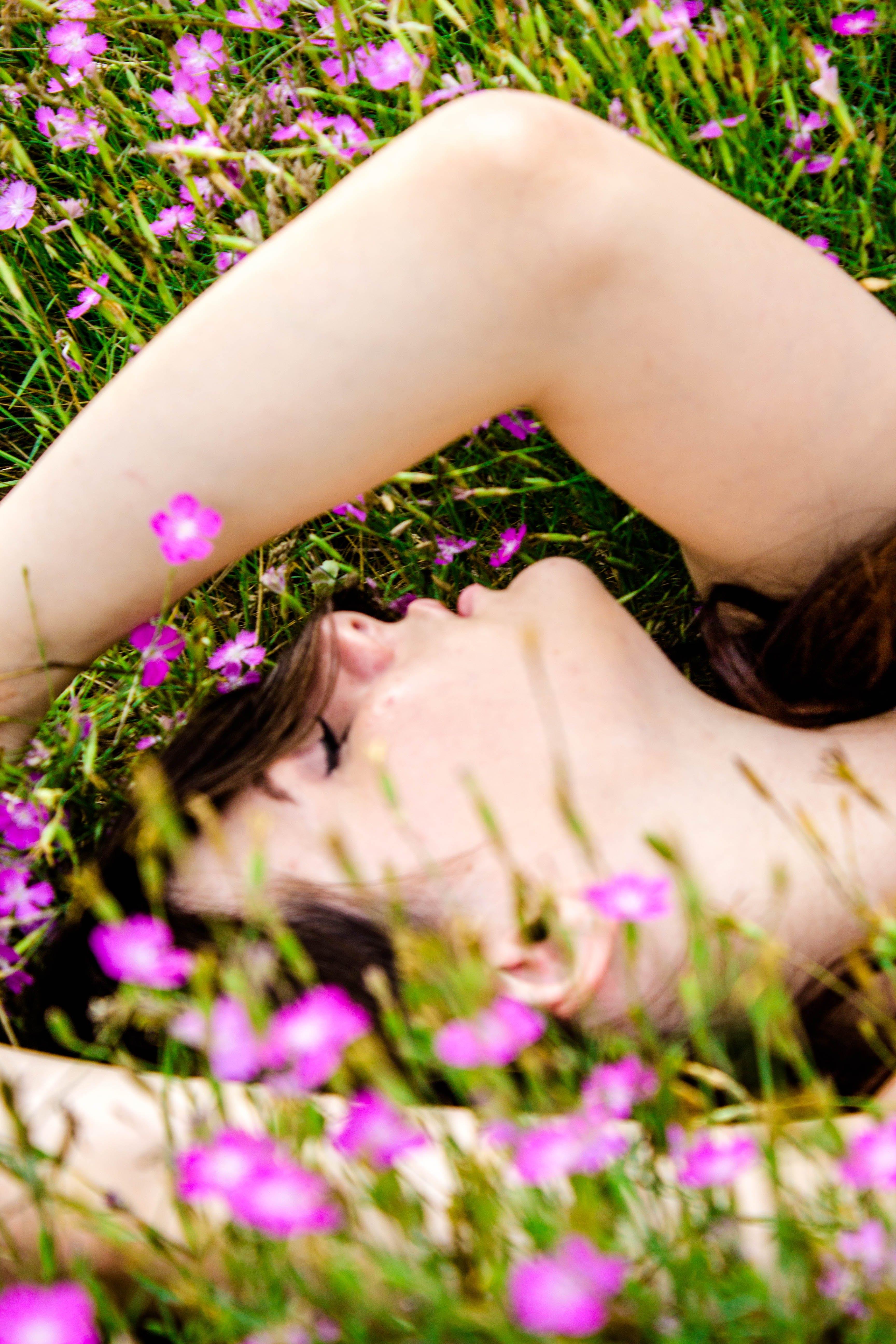 Woman Lying on Flower Field