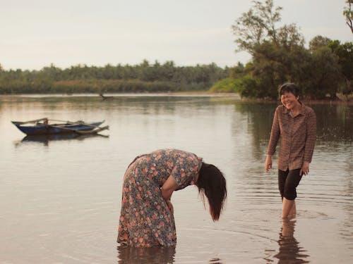 Women Standing in the Water
