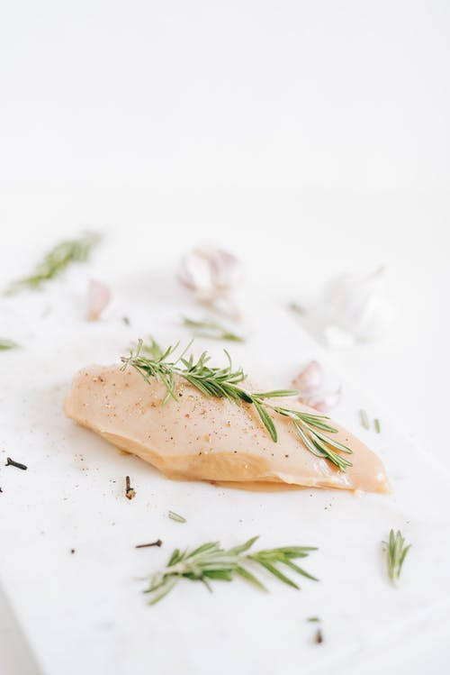 Rosemary on Top of a Chicken Meat