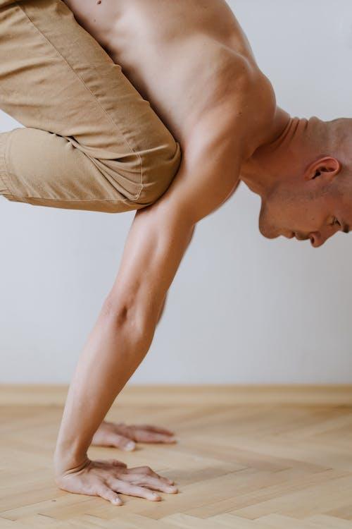 Man in Beige Pants Doing a Handstand