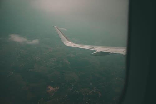 Free stock photo of aeroplane, aircraft wings, airplane window, in flight