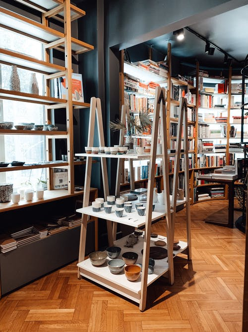 Stand with various ceramic bowls in pottery store