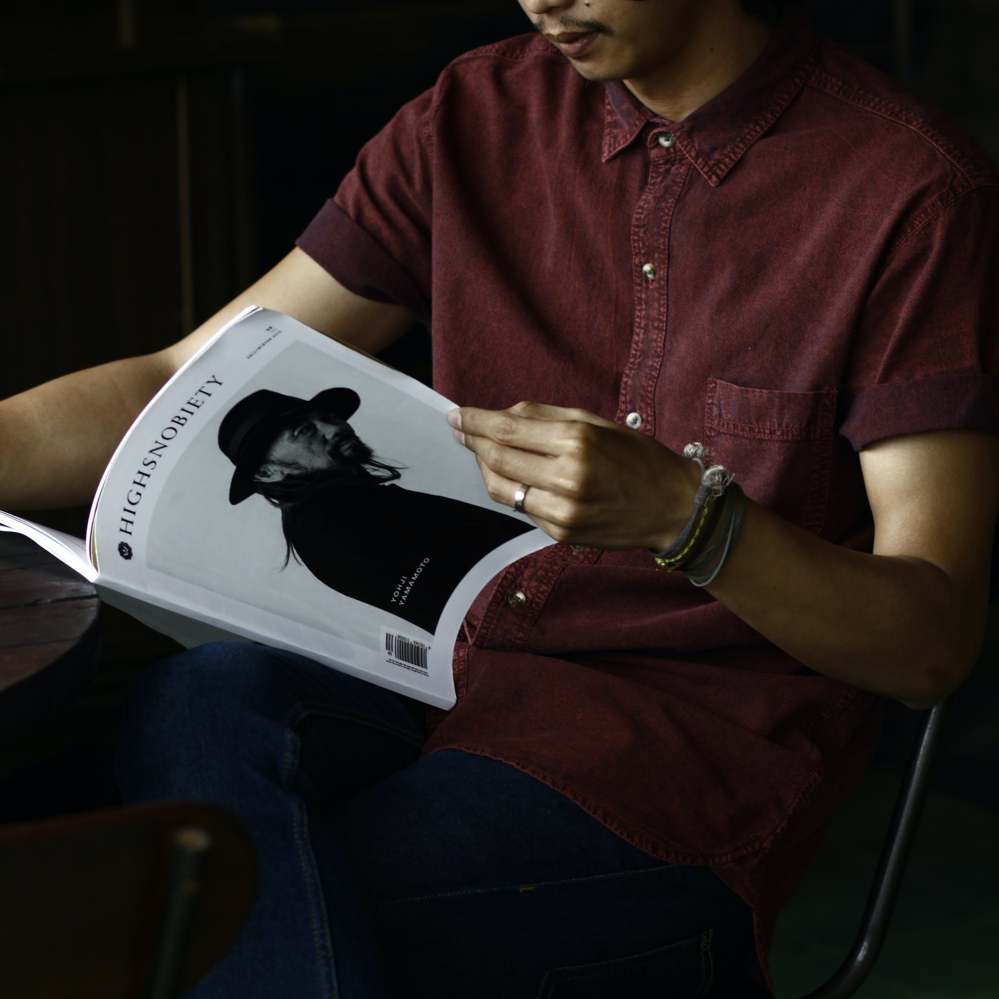 Man Holding Highnoblety Book