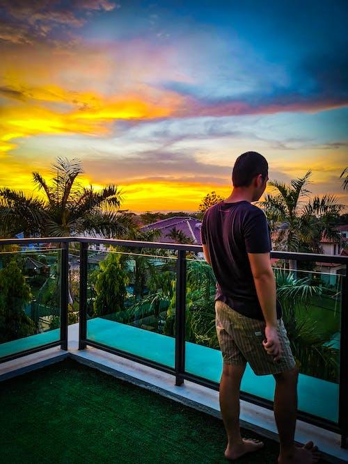 Free stock photo of asian boy, balcony, beautiful landscape
