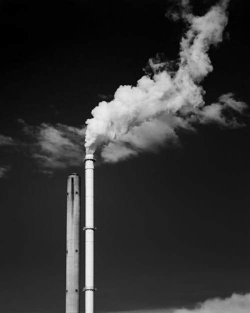 Grayscale Photo of Factory Chimney
