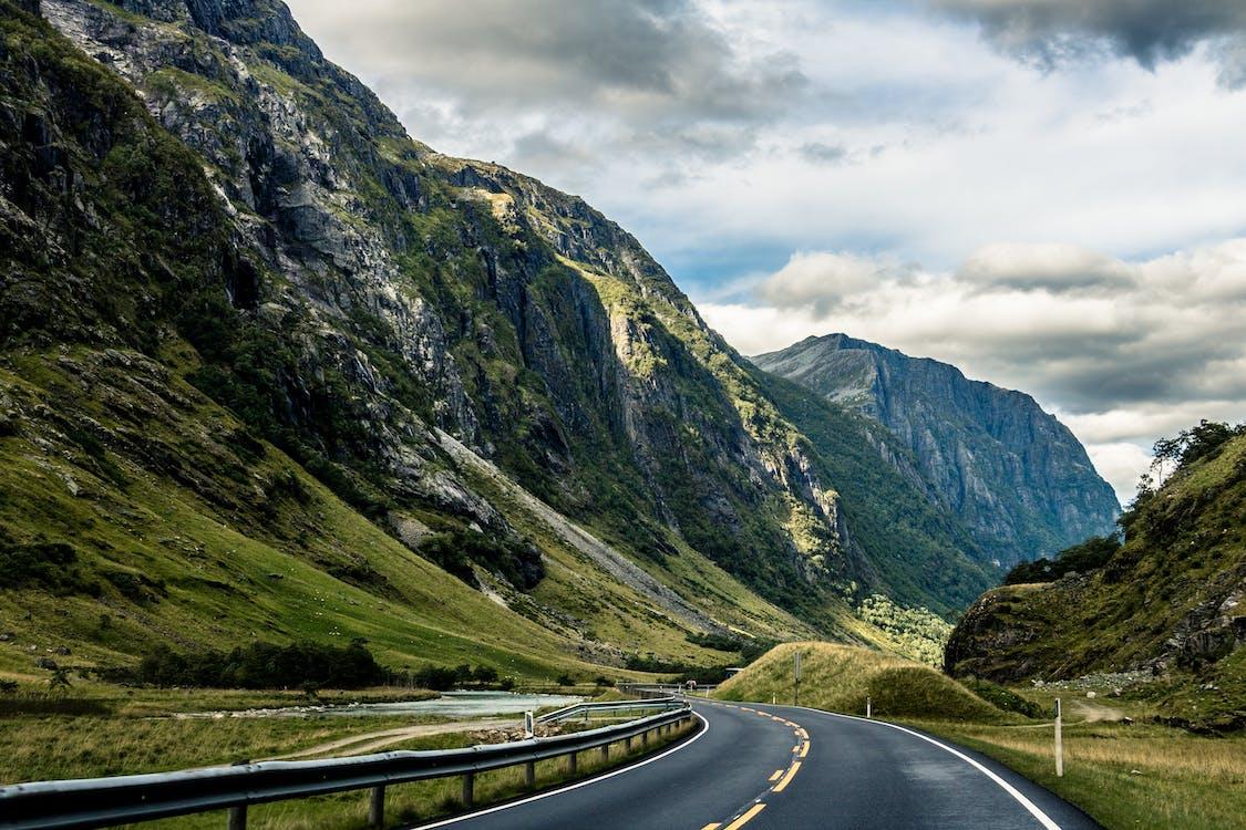 Gray Asphalt Road Between Mountains