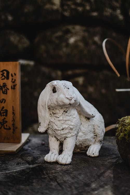 White Ceramic Elephant Figurine on Black Table