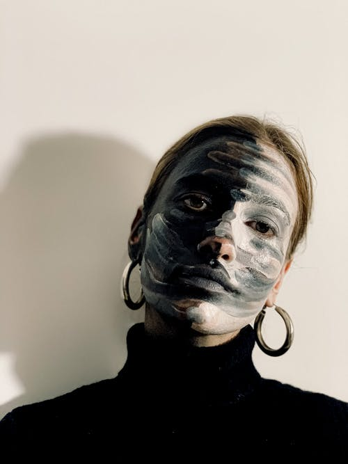 Young woman with paint art on face