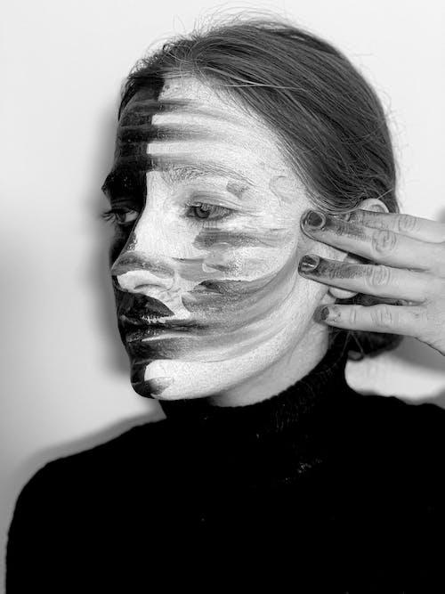 Sad woman with smeared makeup