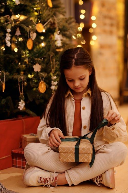 Girl Opening Her Christmas Gift