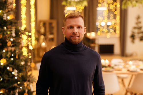 Man in Black Turtleneck Sweater Smiling