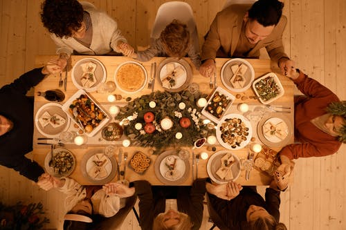 Top View of a Family Praying Before Christmas Dinner