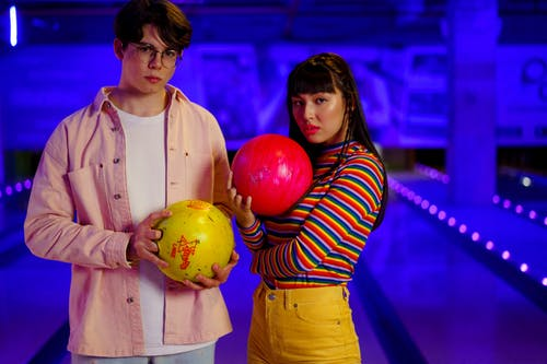 People Holding Bowling Bowls